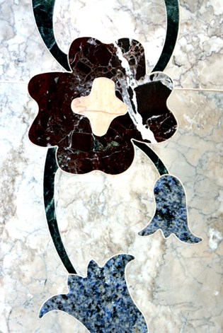 Close Up of Granite Inlay inside a Marble Fireplace Hearth